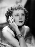 Irene Dunne sitting and Looking Up and Face Leaning on Hand Photo by  Movie Star News