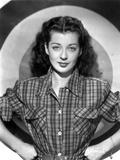 Gail Russell Posed in Checkered Shirt with Target Background Photo by  Movie Star News