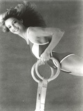 Heather Locklear in a Swimsuit Holding a Gymnastic Equipment Photo by  Movie Star News
