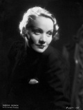 Marlene Dietrich smiling in Black Dress with Black Background Photo by ER Richee