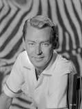 Alan Ladd Side View Pose sitting on the Chair Close Up Portrait Photo by  Movie Star News