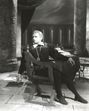 Laurence Olivier Leaning on Chair in Black Jacket Black and White Photo by  Movie Star News