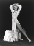 Stella Stevens Showing Leg Pose wearing White Robe in Black and White Photo by  Movie Star News