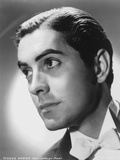 Tyrone  Powers wearing Yellow Sweater in Close Up Portrait Photo af Movie Star News