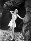 Carole Landis in Printed Bra and Skirt, Hand Leaning on Rock Photo by  Movie Star News