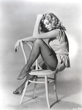 Anita Ekberg sitting on a Chair in a Classic Portrait Photo by  Movie Star News
