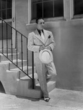 George Raft Leaning on Stair Railing in Formal Outfit With Hat Portrait Photo by  Walling