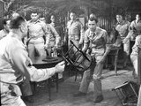 From Here To Eternity Man Carrying a Chair Surrounded By Policemen Photo by  Movie Star News