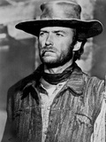 Clint Eastwood Looking Away in Cowboy Attire with Cigarette in His Mouth Foto af  Movie Star News