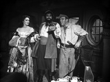 Linda Darnell posed with Two Man in Pirate Outfits in Black and White Photo by  Movie Star News
