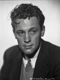 William Holden Looking Away in Black Coat with Curly Hairdo Photo by AL Schafer