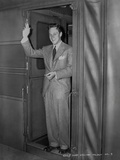 William Holden standing in Classic Suit with One Hand Raising Photo by  Movie Star News