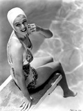 Carole Landis on Printed Swimsuit and sitting on a Dive Board Photo by  Movie Star News