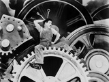Charlie Chaplin sitting on Big Metal in Modern Times Movie Scene Photo by  Movie Star News