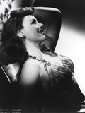 Paulette Goddard Looking Up while Lying, wearing Sexy Dress Portrait Photo by  Movie Star News