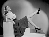 Susan Hayward sitting and Leaning in Skirt with High Heels Photo by  Movie Star News