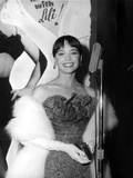 Leslie Caron Smiles wearing Elegant Gown with Fur Coat Photo by  Movie Star News