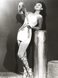 Paulette Goddard Leaning on Post and Looking Up wearing Sexy White Dress Photo by  Movie Star News
