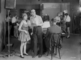 Al Jolson standing with a Woman Near the Piano in a Classic Movie Scene Photo by  Movie Star News