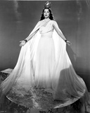Maria Montez Posed in Big and Long White Gown with Arm's Wide Open Photo by  Movie Star News