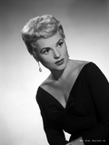 Judy Holliday wearing a V-Neck Dress in a Portrait Photo by  Movie Star News