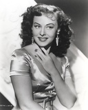 Paulette Goddard smiling in Silk Blouse Portrait Photo by  Movie Star News