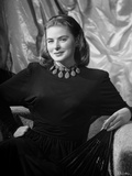 Ingrid Bergman smiling and sitting in a Long Sleeve Blouse Photo by E Bachrach