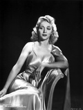 Carole Landis on a Silk Dress sitting and Leaning Photo by  Movie Star News