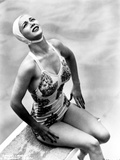 Carole Landis on a Swimsuit sitting on a Dive Board Photo by  Movie Star News