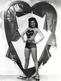 Ann Miller standing in a Heart in a Classic Portrait Photo by  Movie Star News