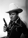 Gene Autry Posed in Cowboy Outfit and Holding Gun Photo by  Movie Star News