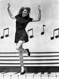Rita Hayworth Music Notes Background in a Dancing Pose Photo by Ned Scott