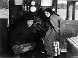 Buster Keaton sitting with Lady wearing a Printed Dress Photo by  Movie Star News