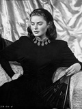 Ingrid Bergman sitting on a Couch in Black Dress Photo by E Bachrach