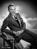 Fred Astaire Suited on Arm Chair in Black and White Photo by Hal McAlpin