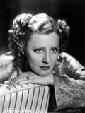 Irene Dunne on Dress sitting and Leaning Portrait Photo by  Movie Star News