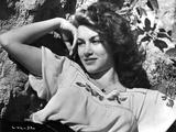 Linda Christian Leaning on Rocks in Classic Portrait Photo by  Movie Star News