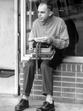 Billy Thorton sitting in Formal Shirt With Books Photo by  Movie Star News
