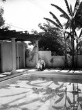 Fred Astaire Seated by the Poolside Black and White Photo by J Miehle