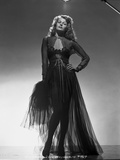 Rita Hayworth Posed in a Black Gown with Hand on Hip Photo by  Hurrell