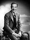 Fred Astaire Seated on Arm Chair in Black and White Photo by Hal McAlpin