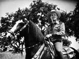 Gene Autry Riding a Horse with Trees on Background Photo by  Movie Star News