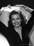 Cyd Charisse smiling in Black Dress with Necklace Photo by  Movie Star News
