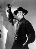 George Hamilton Posed in Cowboy Outfit With Sword Photo by  Movie Star News