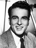 Montgomery Clift Portrait smiling in Black and White Photo by  Movie Star News