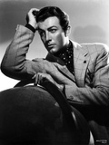 Robert Taylor posed in Suit with Head Leaning on Hand Photo by  Movie Star News