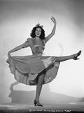Rita Hayworth in Dancing Pose with Skirt and Heels Photo by A.L. Schafer