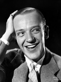 Fred Astaire laughing with Hand on Head in Black and White Photo by E Bachrach