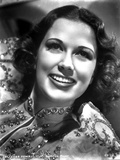 Eleanor Powell on an Embroidered Top and smiling Photo af Movie Star News