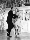 Fred Astaire and Ginger Rogers with Trophies on Cabinet Photo by  Movie Star News